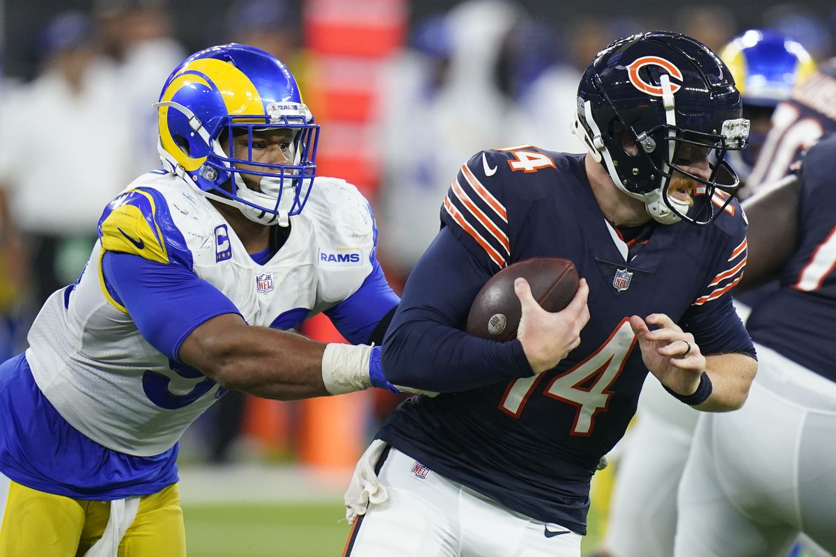 Bears quarterback Andy Dalton is sacked by the Rams' Aaron Donald on Sunday.