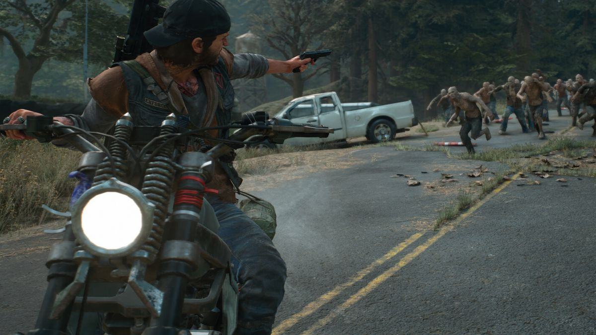 Days Gone - Deacon on his motorcycle, firing at Freakers behind him