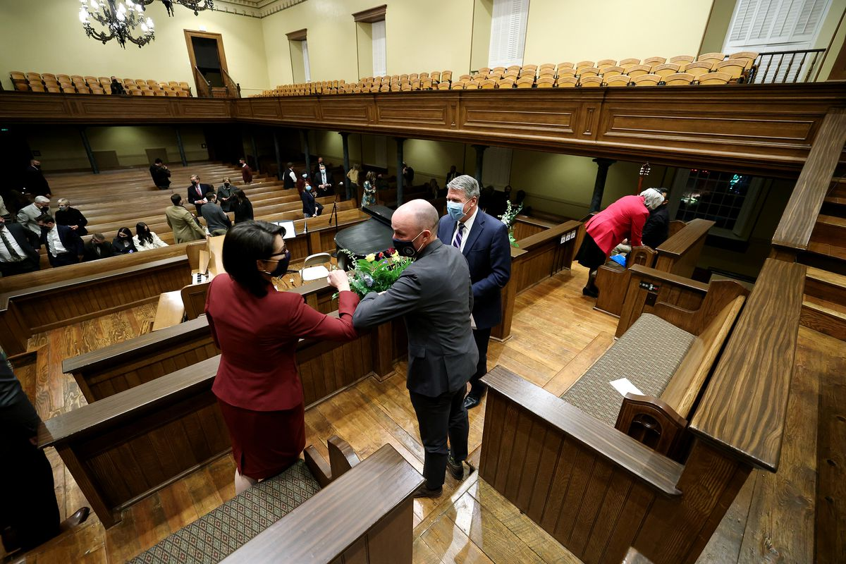 """Lt. Gov.-elect Deidre Henderson, left, and Gov.-elect Spencer Cox talk following a Freedom Fireside, which was livestreamed from the St. George Tabernacle on Sunday, Jan. 3, 2021.The fireside concluded a """"Day of Prayer"""" for Cox and Henderson."""