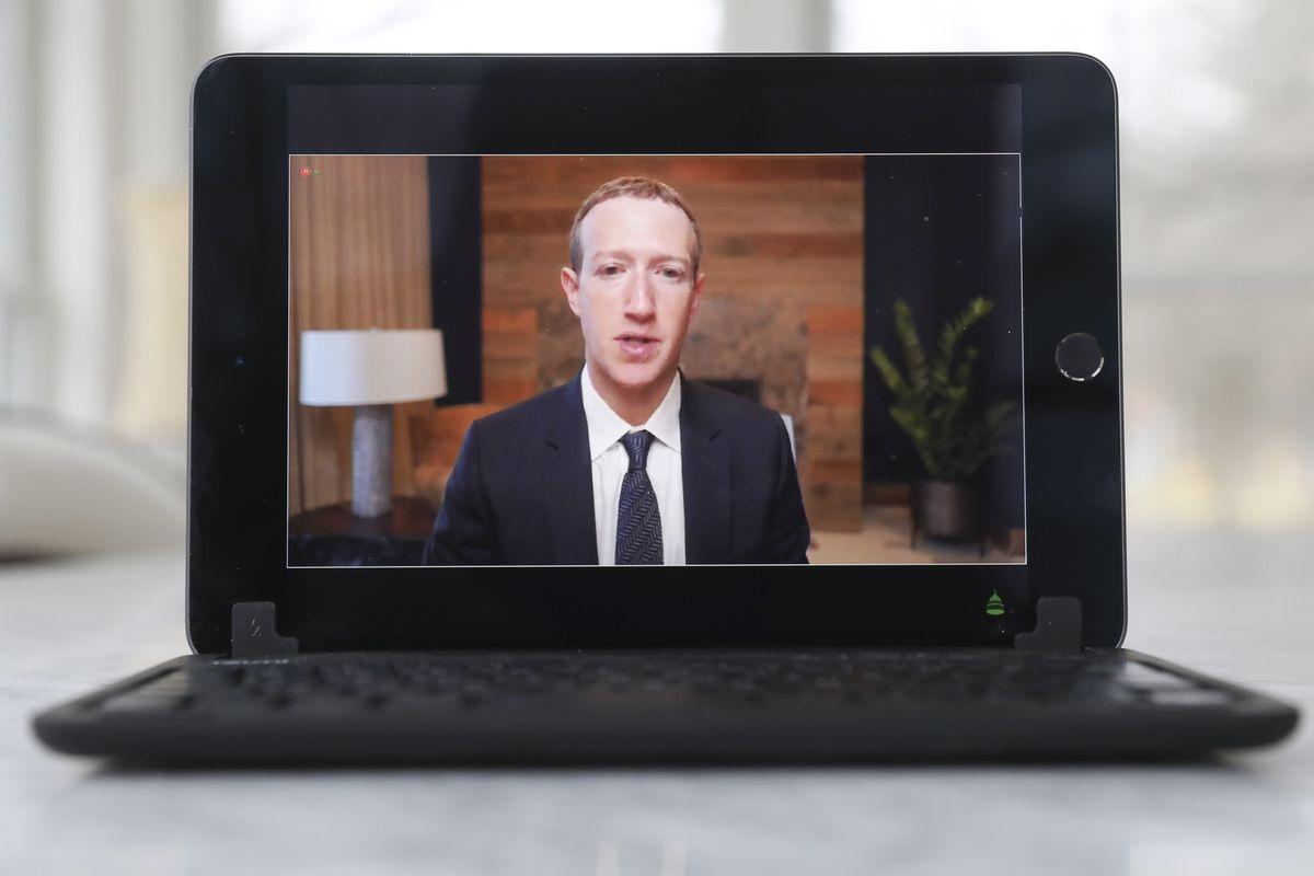 Facebook CEO Mark Zuckerberg on a laptop screen as he speaks to Congress.