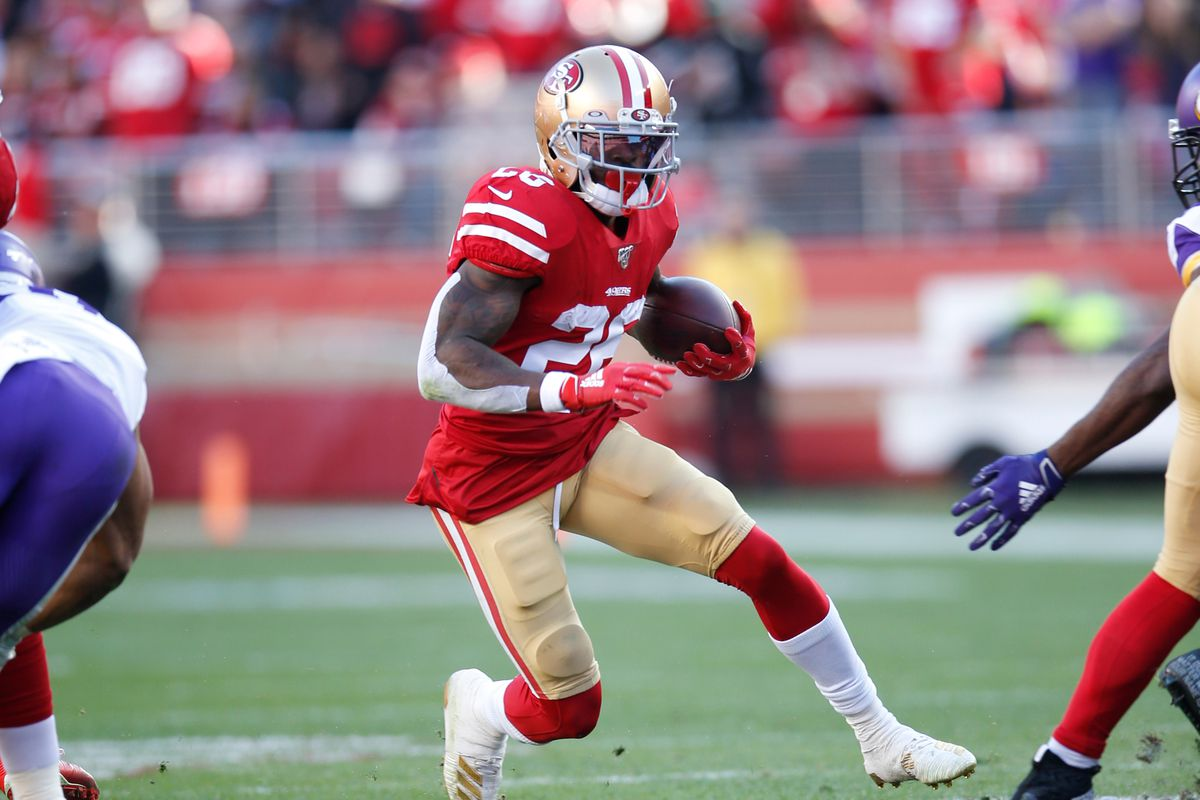 Tevin Coleman #26 of the San Francisco 49ers rushes during the game against the Minnesota Vikings at Levi's Stadium on January 11, 2020 in Santa Clara, California. The 49ers defeated the Vikings 27-10.