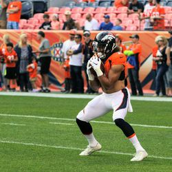 Broncos rookie RB Phillip Lindsay hauls in a kick during warmups before preseason game two.