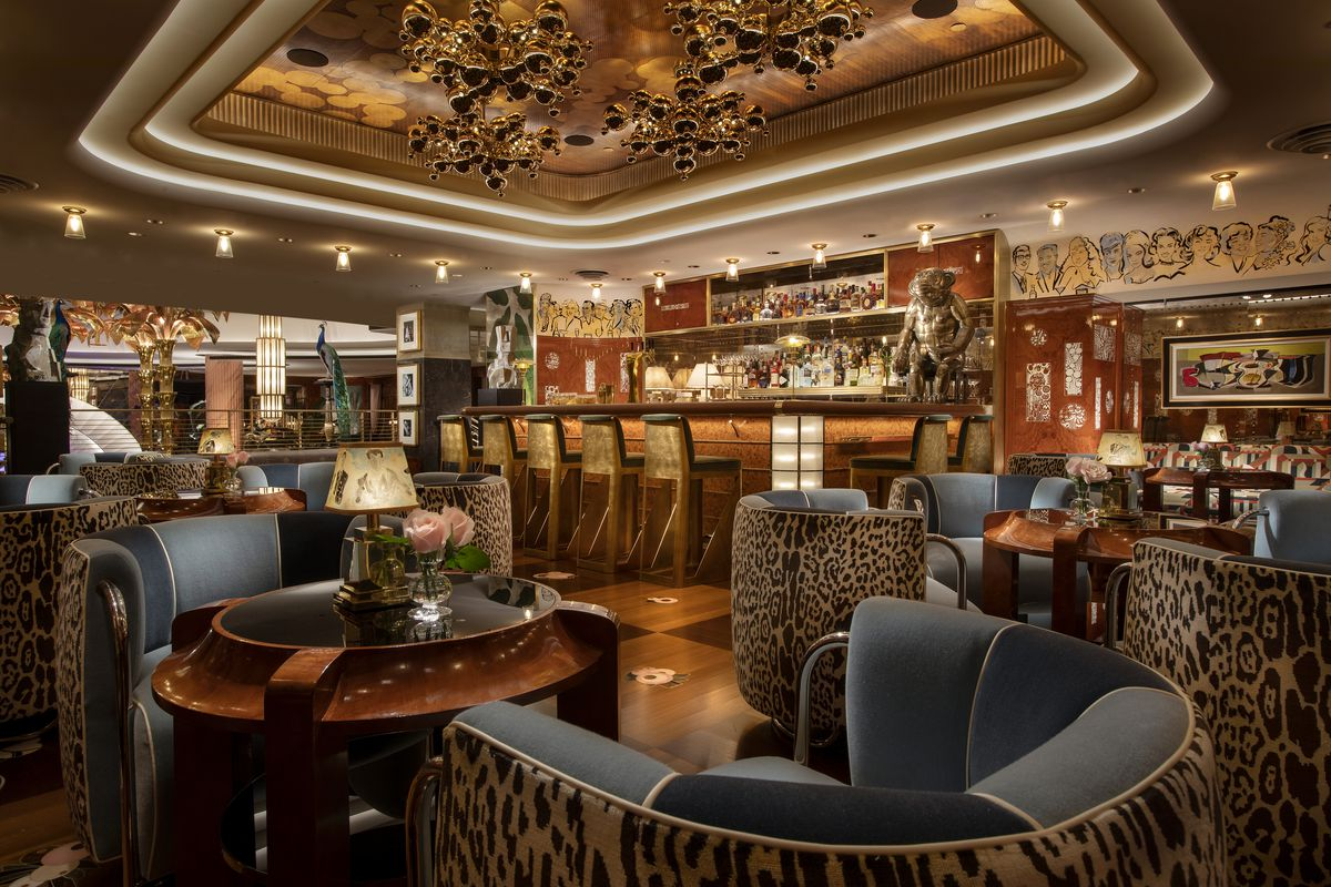 An opulent bar with handsome navy and leopard print chairs