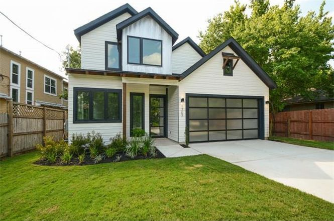 White two-story contemporary/modern farmhouse