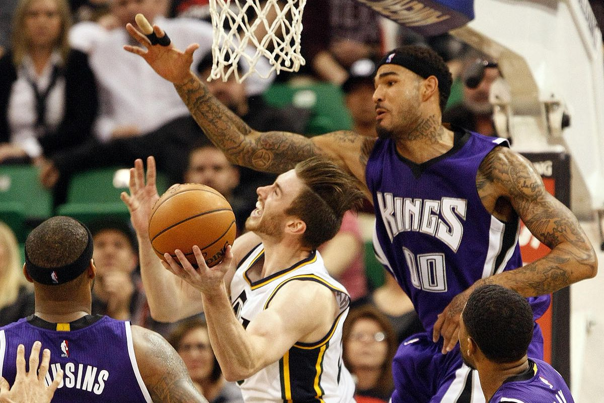 Utah Jazz forward Gordon Hayward, center, is fouled while taking a shot in the second half of an NBA basketball game against the Sacramento Kings at Vivint Arena in Salt Lake City, Thursday, Jan. 14, 2016.
