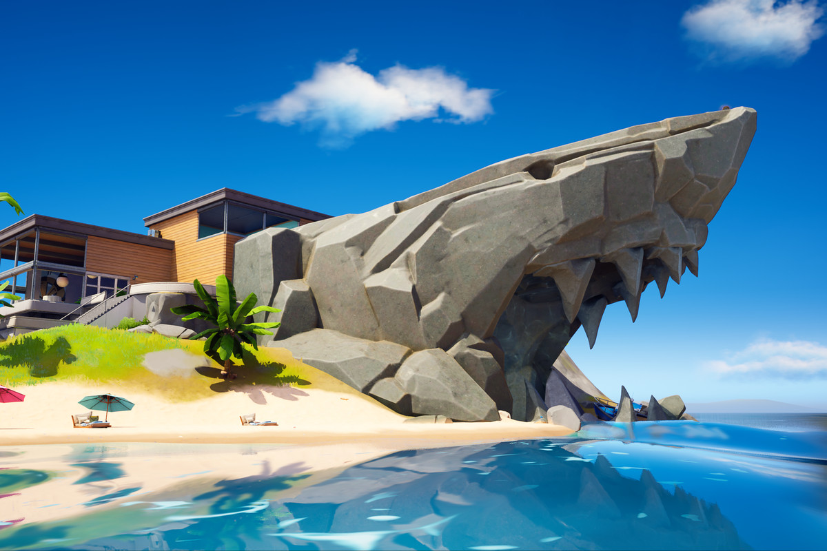 A giant rock shaped like a shark with a secret lair behind it in Fortnite chapter 2 season 2