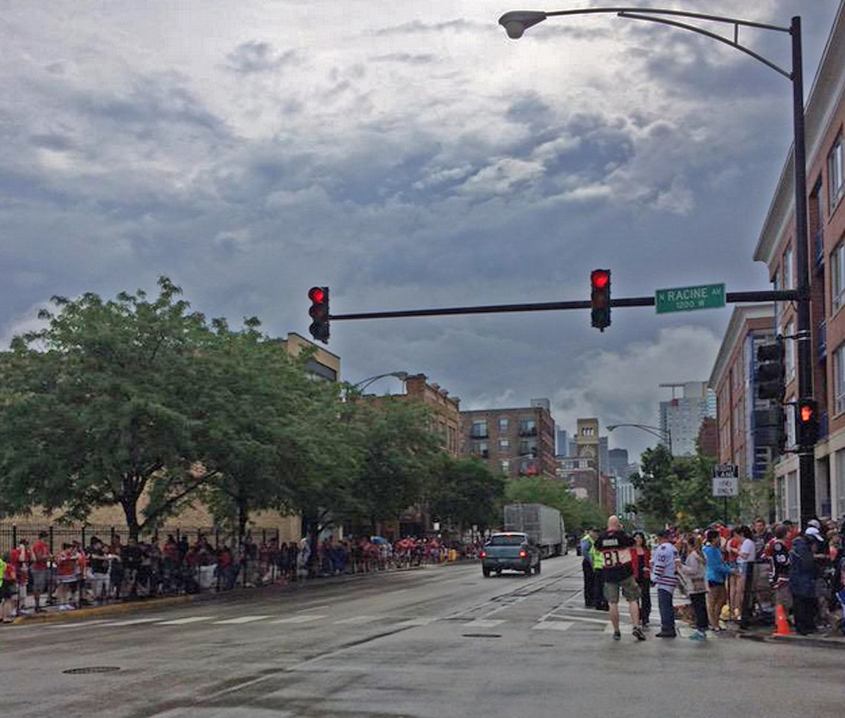 Rain chases the crowd away, at least temporarily, at Washington and Racine, where the parade starts in about an hour. | Diana Novak Jones/Sun-Times