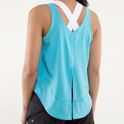 """<b>Lululemon</b> Featherweight Singlet in Spry Blue, <a href=""""http://shop.lululemon.com/products/clothes-accessories/women-tanks/Run-Featherweight-Singlet?cc=4165&skuId=3504197&catId=women-tanks"""">$68</a>"""