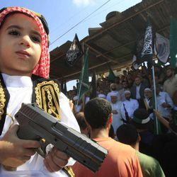 A boy holds a toy gun during a protest about a film ridiculing Islam's Prophet Muhammad in the Palestinian refugee camp of Ain el-Hilweh near Sidon, Lebanon, Friday, Sept. 14, 2012.
