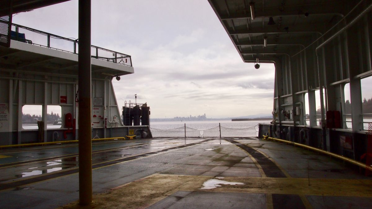 The view from the end of a car dock on a passenger ferry into the Puget Sound