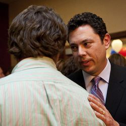 Rep. Jason Chaffetz, R-Utah, pats the shoulder of a supporter at the Utah Republican Party results party, Tuesday, Nov. 6, 2012.
