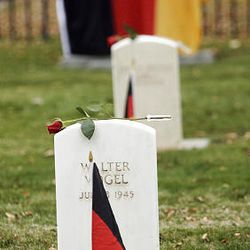Graves of German soldiers are adorned with their national flag in commemoration of that nation's day of mourning.