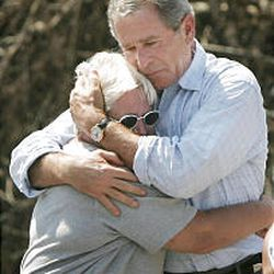 President Bush hugs hurricane victim Sandra Patterson on Friday. Her home was destroyed in Biloxi, Miss.