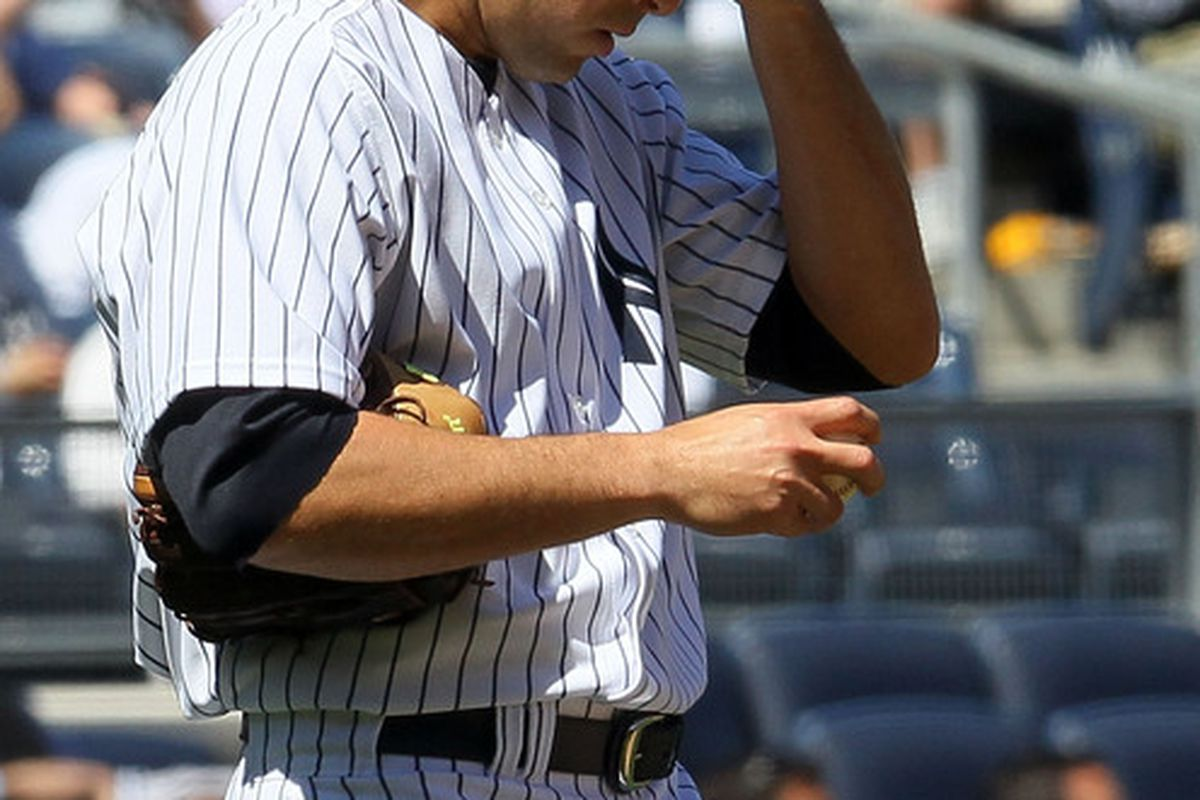 Javier Vazquez of the New York Yankees reacts after giving up a second run in the third inning against the Los Angeles Angels of Anaheim on April 14, 2010 at Yankee Stadium in the Bronx borough of New York City.