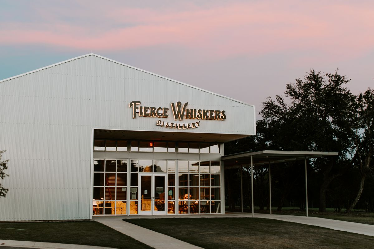 White building with Fierce Whiskers sign against a pretty sunset