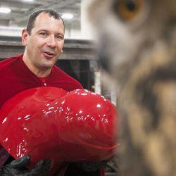Brett Ontiveros admires an owl during Salt Lake Comic Con at the Salt Palace Convention Center in Salt Lake City, Thursday, Sept. 4, 2014.