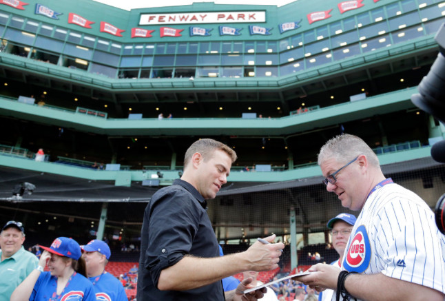 <em>Epstein signs for fans before the game</em>