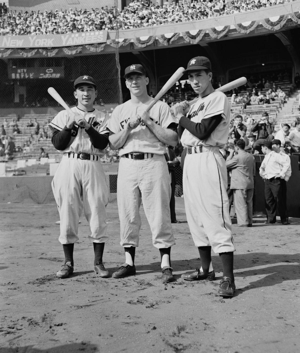 Japanese Baseball Players Posing with Bats