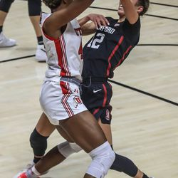 Utah Utes forward Peyton McFarland (42) moves with the ball against Stanford Cardinal guard Lexie Hull (12) during a women's basketball game at the Huntsman Center in Salt Lake City on Friday, Jan. 15, 2021.