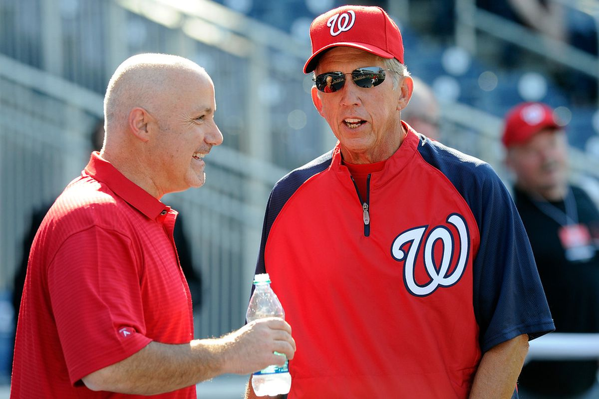 Manager Davey Johnson and general manager Mike Rizzo of the Washington Nationals talk before the game against the Pittsburgh Pirates at Nationals Park on July 1, 2011 in Washington, DC.  (Photo by Greg Fiume/Getty Images)