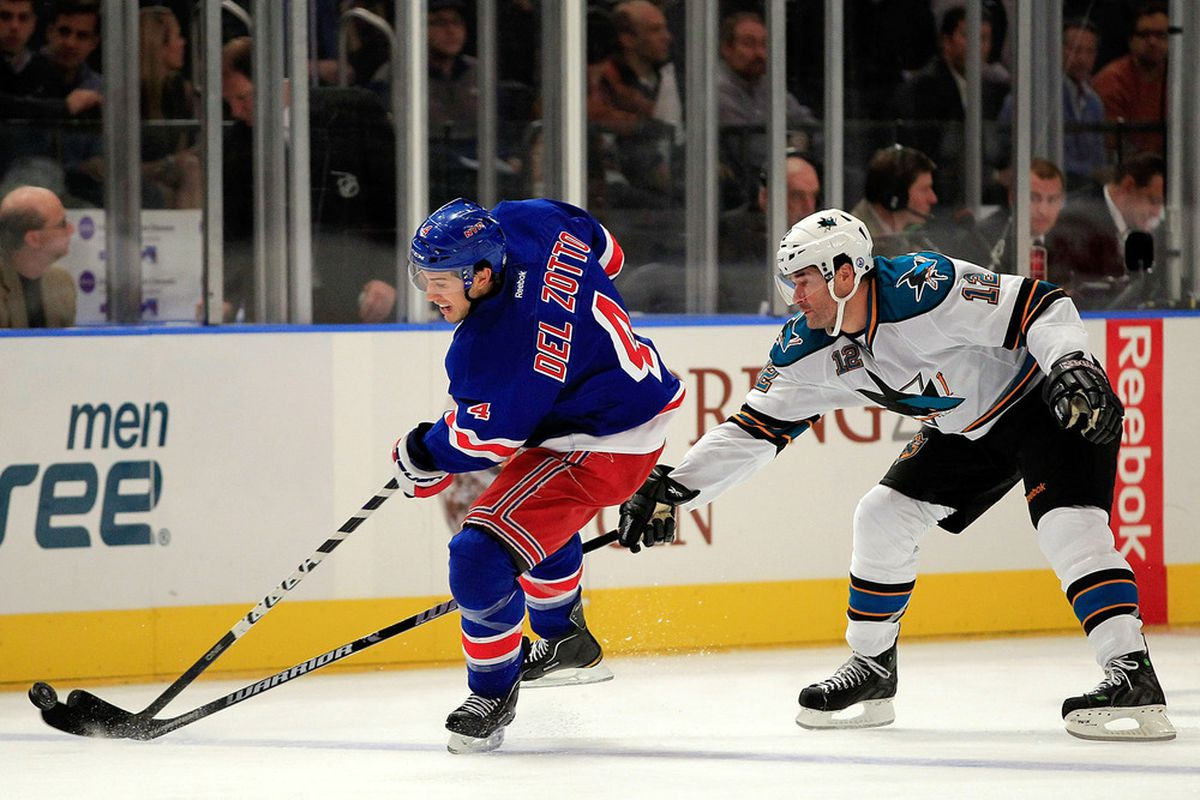 NEW YORK - OCTOBER 31: Michael Del Zotto #4 of the New York Rangers is challenged by Patrick Marleau #12 of the San Jose Sharks at Madison Square Garden on October 31, 2011 in New York City.  (Photo by Chris Trotman/Getty Images)