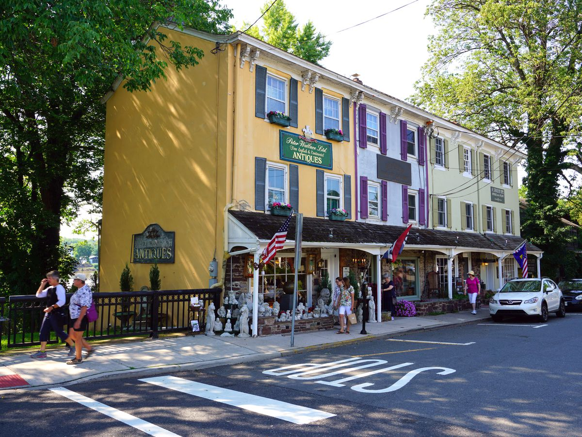 A street in Lambertville, Pennsylvania. There are multicolor houses and shops.