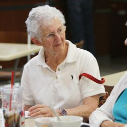 Mary Jo Rehmer talks with friends while eating lunch at Millcreek Senior Center in Salt Lake City Wednesday, May 21, 2014.