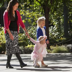 Kiersten Walker walks with her daughters Precia and Audrie during the Saturday afternoon session of the 183rd Semiannual General Conference for the Church of Jesus Christ of Latter-day Saints Saturday, Oct. 5, 2013 inside the Conference Center.