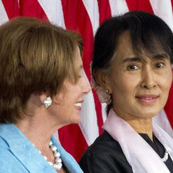 Myanmar democracy leader Aung San Suu Kyi, right, sits with House Democratic Leader Nancy Pelosi, D-Calif., during a ceremony to award Suu Kyi with the Congressional Gold Medal at the U.S. Capitol in Washington, on Wednesday, Sept. 19, 2012.