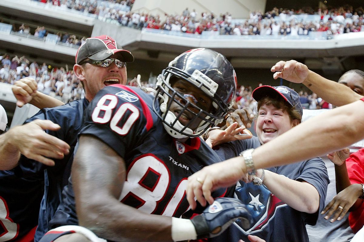 Jerry Holt/Star Tribune Houston TX Vikings at Texans 10/10/04 #89807------Andre Johnson was the bright spot in Houstons offense her he clebrates with fans after tying the game in the 4th quarter during Sunday aftenoon NFL action at Relaiant Stadium in Ho