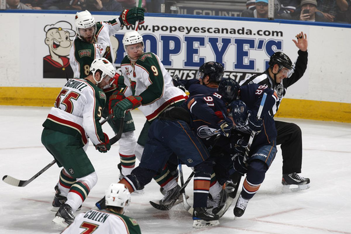 """In this picture: Four members of the Wild watch as the Oilers check themselves, and and official does his interpretive dance entitled """"I'm a little teapot, short and blind."""""""