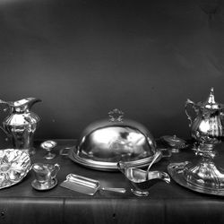 Hotel Utah silver pieces to be auctioned include serving trays, pitchers and various dishes, many featuring the hotel's insignia.