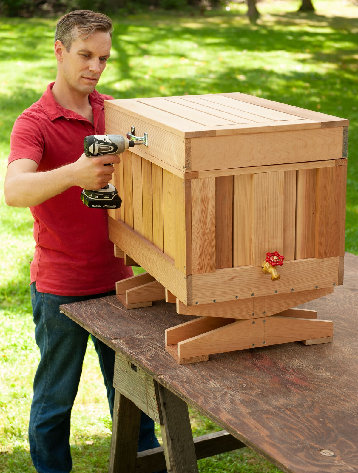 Man Adds Lid Handle And Bottle Opener To Finished Cedar Ice Chest