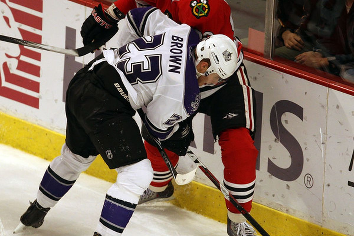 Tomas Kopecky gets checked by Dustin Brown, catches a high stick, and mourns the loss of Hossa, all in one face.