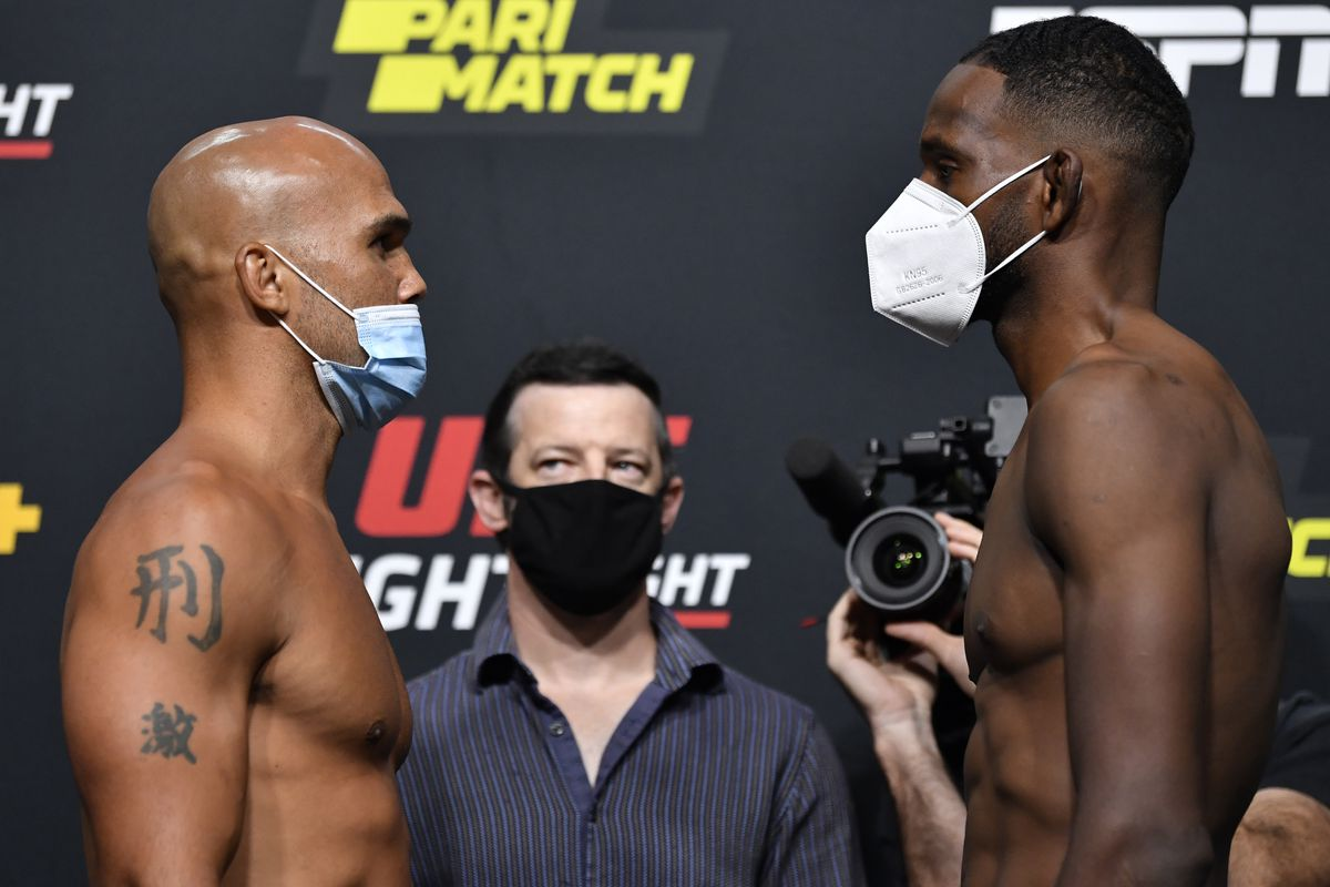Opponents Robbie Lawler and Neil Magny face off during the UFC Fight Night weigh-in at UFC APEX on August 28, 2020 in Las Vegas, Nevada.