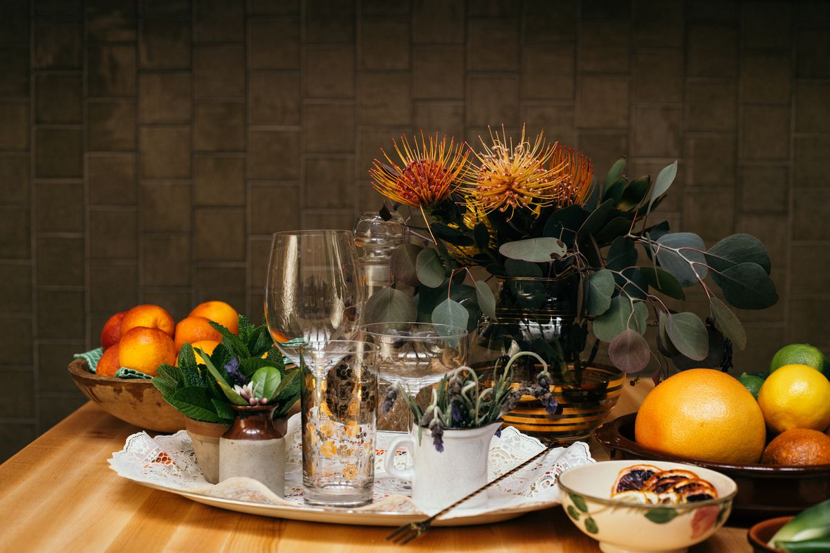 Orange and green touches for a tablescape at a new throwback restaurant.