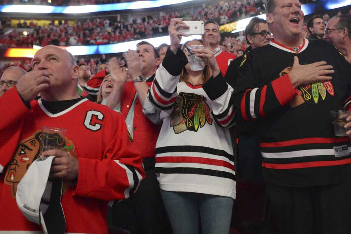 1d696d91620 Chicago Blackhawks fans cheer during a playoff series in April 2017. | Joe  Lewnard/AP file