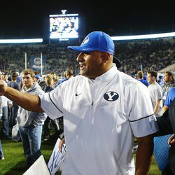 Brigham Young Cougars head coach Kalani Sitake greets fans after his team defeated Mississippi State 28-21 in overtime in Provo at LaVell Edwards Stadium on Friday, Oct. 14, 2016.