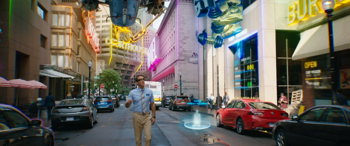 Ryan Reynolds as the guy walking down a street in Free Guy who is surprised by neon holographic displays.