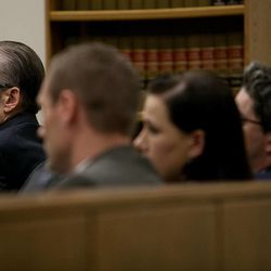 Martin MacNeill sits with his defense counsel during his trial at the Fourth District Court in Provo Wednesday, Nov. 6, 2013. MacNeill is charged with murder for allegedly killing his wife Michele MacNeill in 2007.