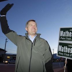 Rep. Jim Matheson campaigns during a honk and wave at 13400 South and Bangerter Highway in Riverton on Friday, Nov. 2, 2012. Matheson announced on Tuesday, Dec. 17, 2013, that he will not seek re-election in 2014.