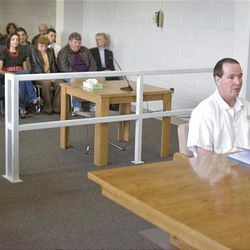Thomas Noffsinger sits at a parole hearing Tuesday as family members of Victor Aguilar and Annette Hill watch.