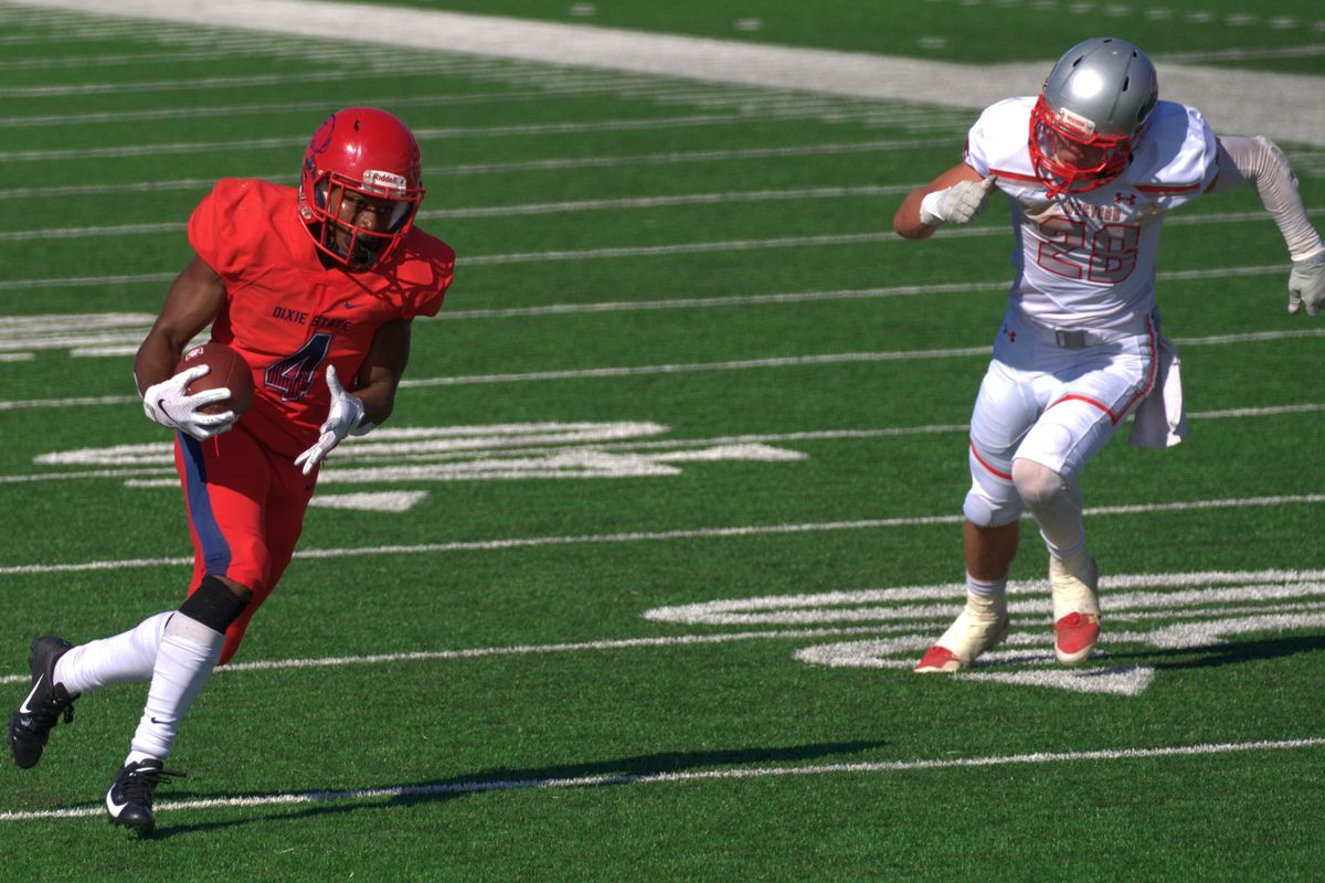 Dixie State receiver Xavier Smith (left) sprints to the end zone for the winning touchdown against Western Colorado on Saturday.