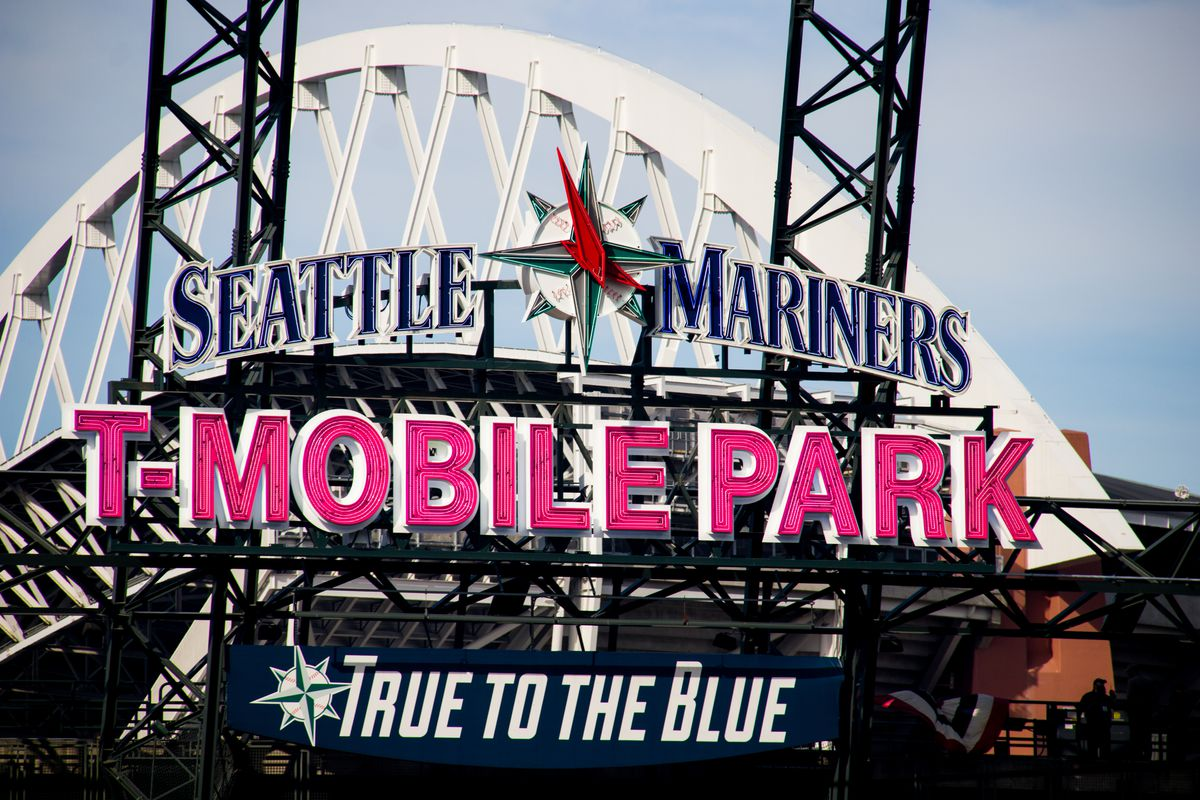 """The front of T-Mobile Park with the Seattle Mariners logo displayed prominently and the phase """"True to the Blue"""" below"""