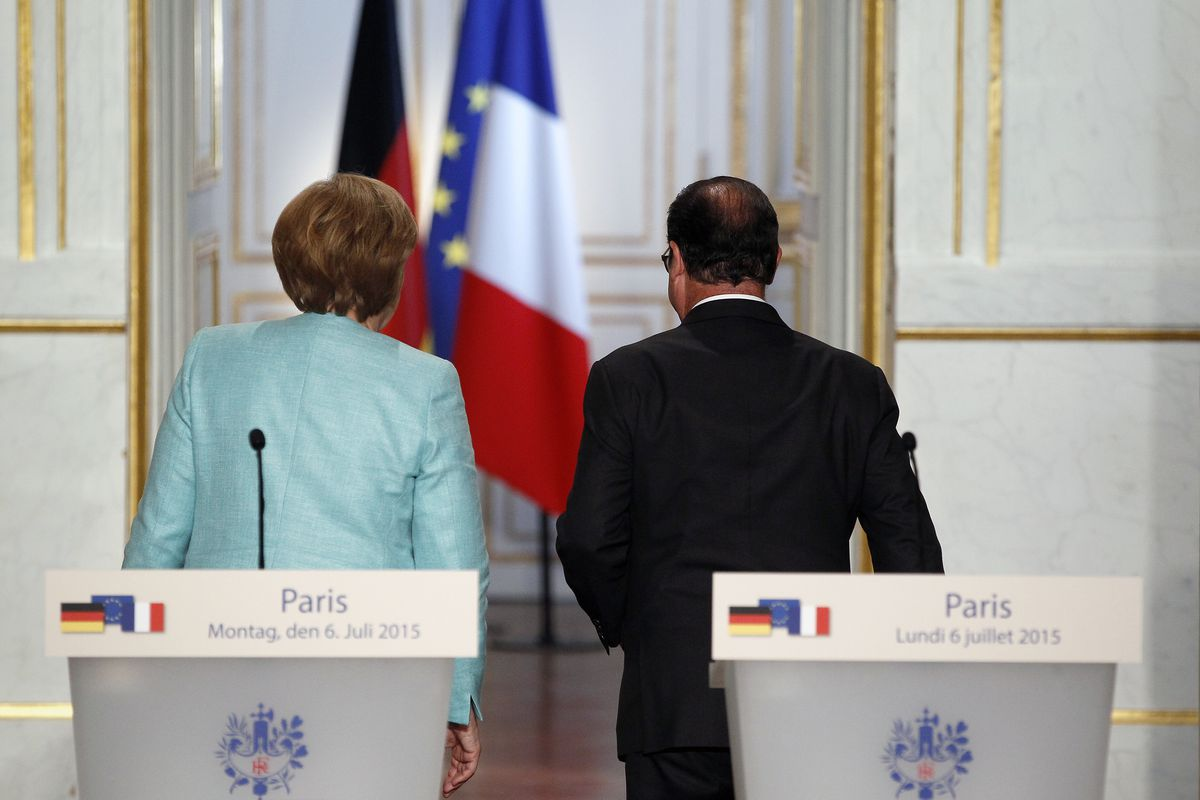 German Chancellor Angela Merkel and French President François Hollande leave after a press conference at the Elysée Palace on July 06, 2015, in Paris, France.