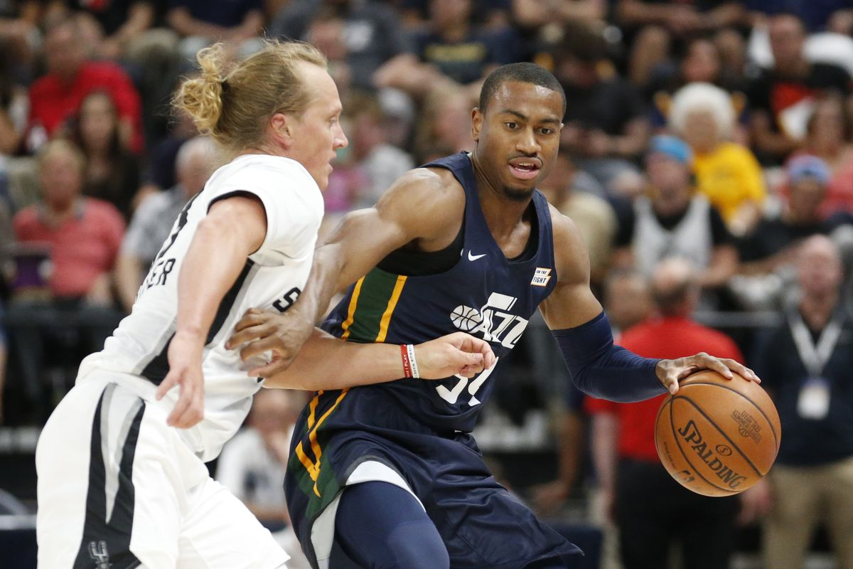 Utah Jazz guard Trey Lewis, right, brings the ball up court as San Antonio Spurs' Jeff Ledbetter, left defends during the first half of an NBA summer league basketball game Monday, July 2, 2018, in Salt Lake City. (AP Photo/Rick Bowmer)