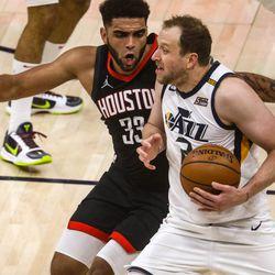 Utah Jazz guard Joe Ingles (2) moves around Houston Rockets forward Anthony Lamb (33) as the Utah Jazz and the Houston Rockets play an NBA basketball game at Vivint Arena in Salt Lake City on Saturday, May 8, 2021.