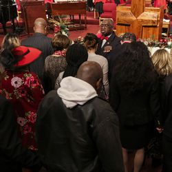 Churchgoers gather around Rev. France Davis to receive a prayer during a service at Calvary Baptist Church in Salt Lake City on Sunday, Dec. 22, 2019. Rev. Davis is planning to retire at the end of the year after having been pastor of the church since 1974.