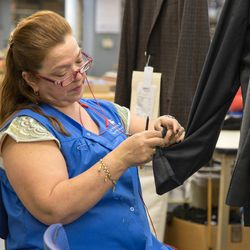 An employee works at the Brooks Brother's tie factory in Long Island City, Queens. The company won an Age Smart Employer Award for its policies that embrace older workers, in 2015.