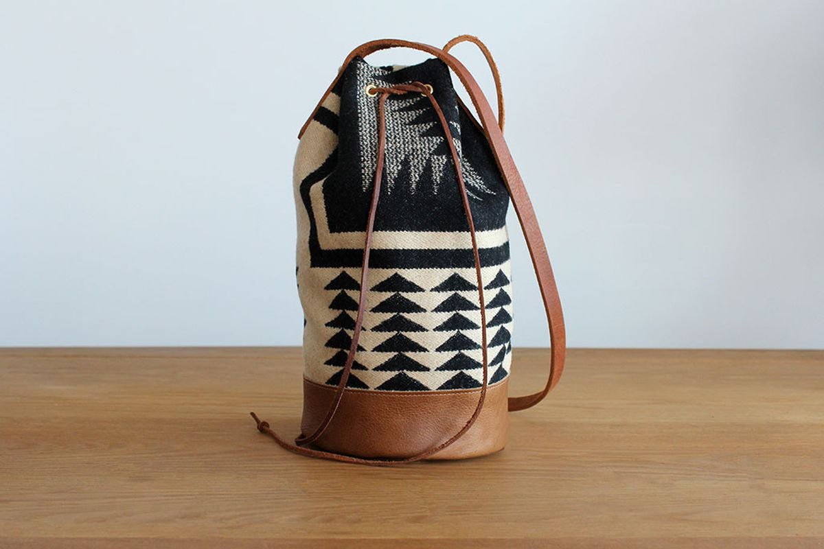 """Future Glory Co. x Pendleton Bucket Bag, <a href=""""http://futureglory.co/collections/current/products/pendleton-x-future-glory-co-bucket-bag"""">$185</a>"""